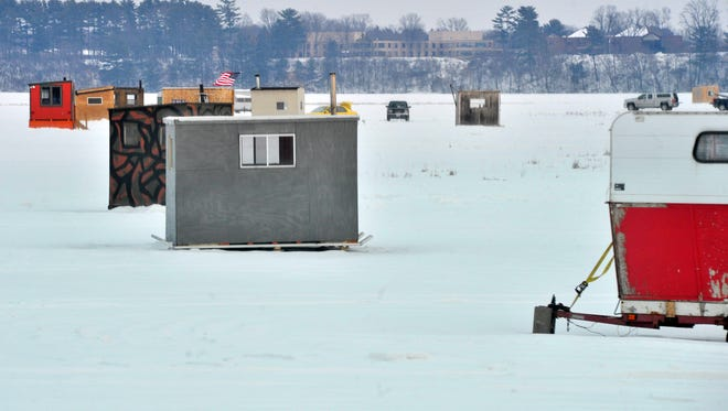 A community of ice shanties setup on Wisconsin River near Rookery Park in Wausau.