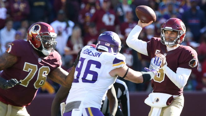 Washington Redskins quarterback Kirk Cousins (8) throws the ball as Minnesota Vikings defensive end Brian Robison (96) chases in the first quarter at FedEx Field.
