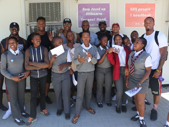 The group of NFL players visiting Silikamva High School