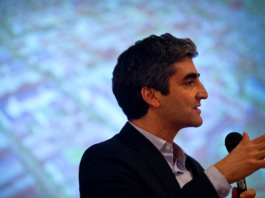 Mayor Miro Weinberger speaks to a crowd of more than 100 that packed into a vacant store space at the Burlington Town Center mall during a presentation Tuesday night outlining the latest redevelopment plan.