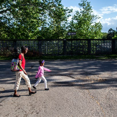 Monte Brooks, 9, walks to his drop-off place at Pisgah View Apartments, after the Children First/Communities in Schools after school program, Wednesday.
