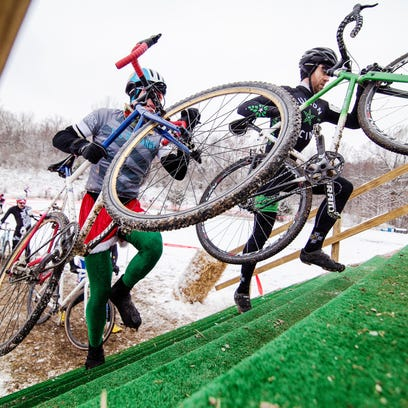 Competitors speed around the course during the junior boys and girls race during the annual Jingle Cross Cyclocross Race at the Johnson County Fairgrounds on Sunday, November 15, 2014.