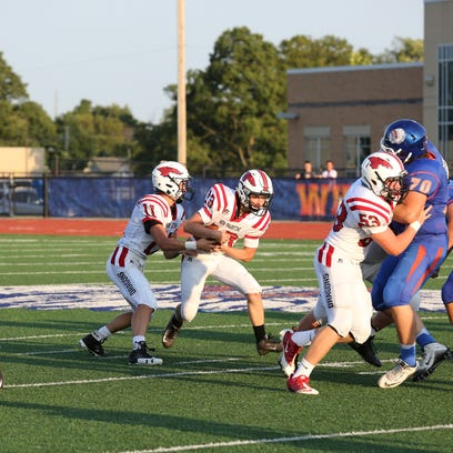 Zach Neligh's 207 rushing yards leads New Palestine to 19-8 victory over Whiteland