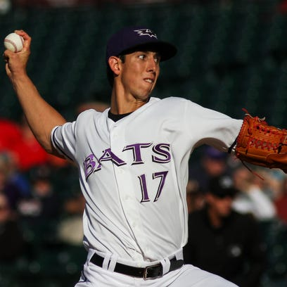 Louisville pitcher Michael Lorenzen throws a pitch while playing the Toledo Mud Hens at Louisville Slugger Field in Louisville, Ky. April 11, 2015.