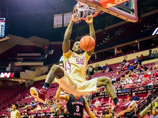 Michael Ojo (50) dunks the ball during the 104-76 Florida State University win against Valdosta State on Thurs., Nov. 03 at the Donald L. Tucker Center in Tallahassee, FL.