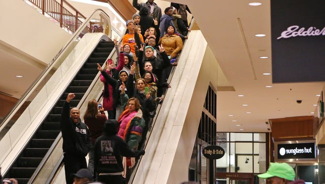 Protesters of the grand jury decision in the Michael Brown shooting chant slogans at the Saint Louis Galleria mall on Wednesday evening, Nov. 26, 2014, in Richmond Heights, Mo. Dozens more interrupted holiday shopping at major retailers around the St. Louis area late Thursday and early Friday.