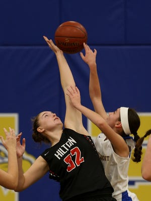Hilton's Meaghan McGwin (32) goes up for the block against Irondequoit's Megan Dano.