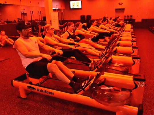 Members of Orangetheory Fitness in Spartanburg use rowing machines during a work out. An Orangetheory studio recently opened at Brookfield Square, along with a new Venezualan restaurant.