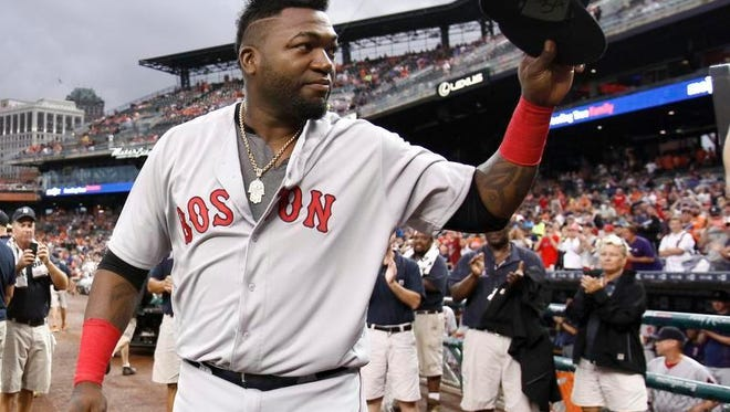 Boston's David Ortiz acknowledges fans at Comerica Park as he is honored by the Tigers before Saturday's game, in Detroit. Ortiz has announced his retirement following this season.