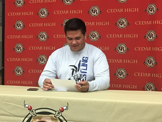 Cedar High School's Daniel Jordan signs his letter