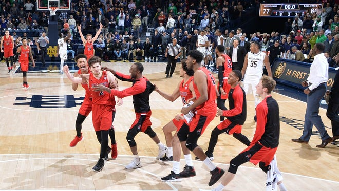 Dec. 5: Ball State Cardinals guard Tayler Persons (2) celebrates with his teammates after making the game-winning shot in the second half against the Notre Dame Fighting Irish at the Purcell Pavilion.