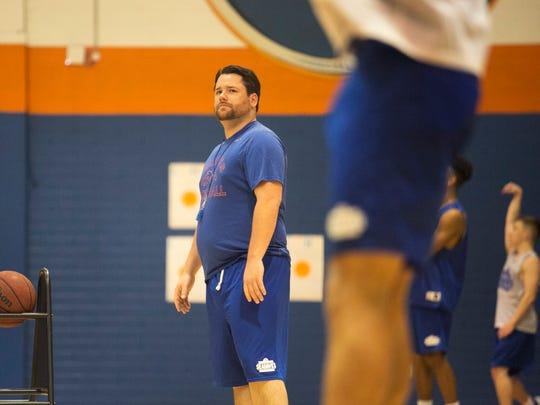 Cape Coral basketball coach Brandon Sensor watches