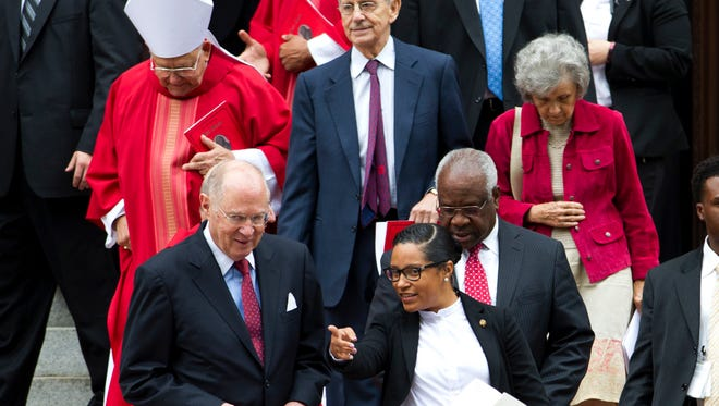 U.S. Supreme Court Justices Anthony M. Kennedy, left, Stephen Breyer, center, and Clarence Thomas, leave St. Mathews Cathedral, after the Red Mass in Washington on Sunday, Oct. 4, 2015.