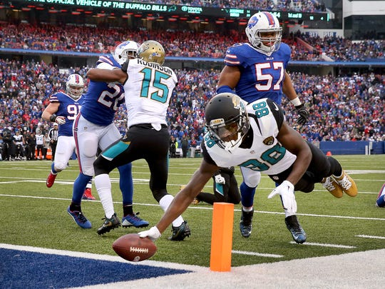 Jaguars receiver Allen Hurns dives into the corner of the end zone for a 12-yard touchdown catch.