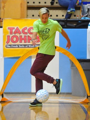 Abby Wambach shows off a little fancy footwork while passing the soccer ball around with kids during Get Fit Great Falls' fourth annual Come Out and Play event in September.