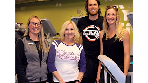 Trevor and Erin Wittwer (right) are the new owners of Anytime Fitness in Sleepy Eye and Springfield. They are pictured with Manager Angel Gessner and former owner Colleen Braun.