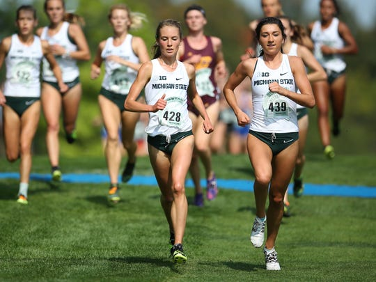 Michigan State University's Maggie Farrell (center) has been named the Big Ten Conference Freshman of the Year in women's cross country.