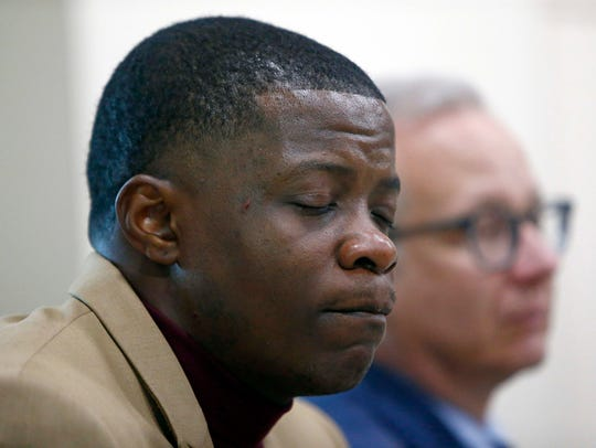 Hero James Shaw holds back tears during a press conference