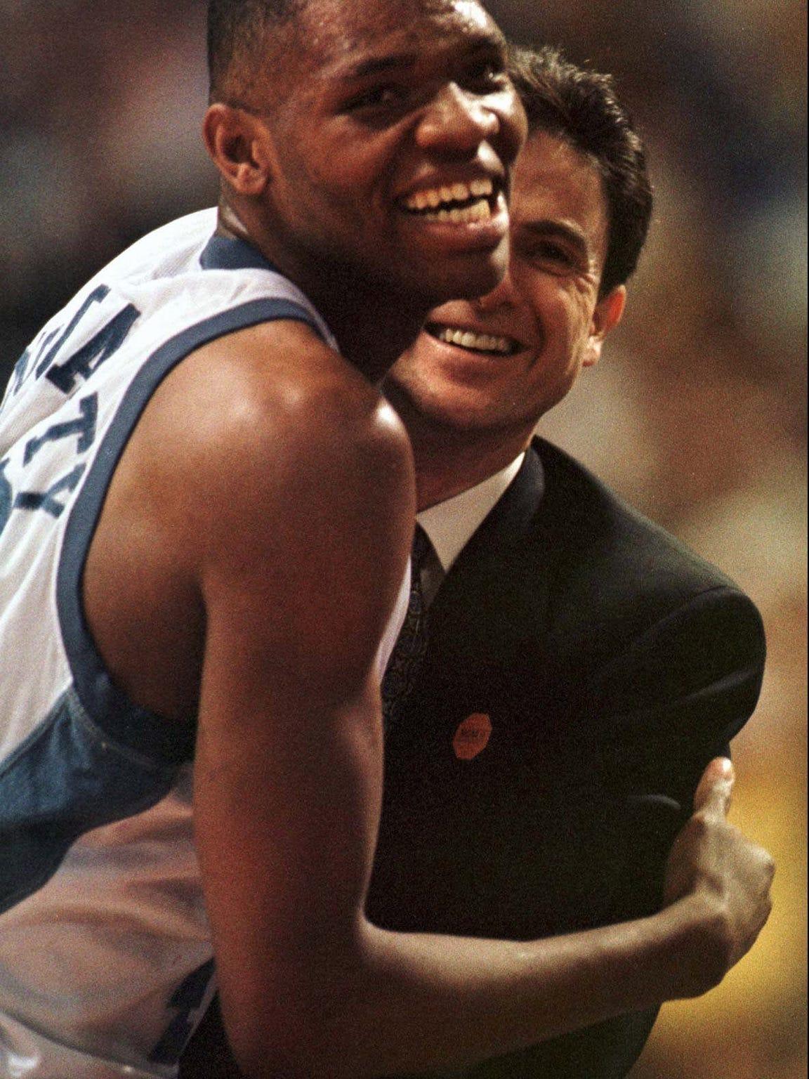 --Kentucky's Walter McCarty celebrates with coach