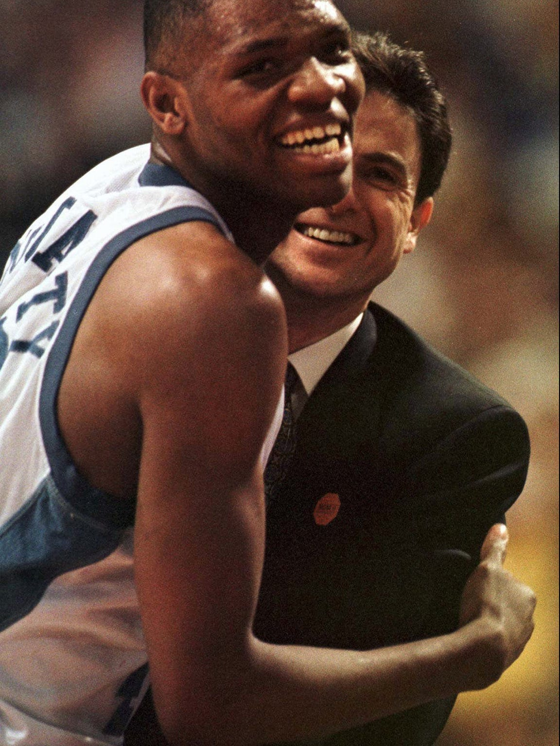 --Kentucky's Walter McCarty celebrates with coach Rick Pitino after their 83-63 win over Wake Forest in the NCAA Midwest Regional finals Saturday, March 23, 1996, in Minneapolis. (AP Photo/Morry Gash)