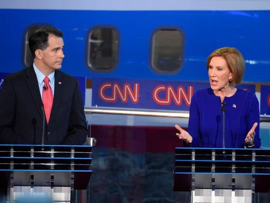 Republican presidential candidate Carly Fiorina, right,