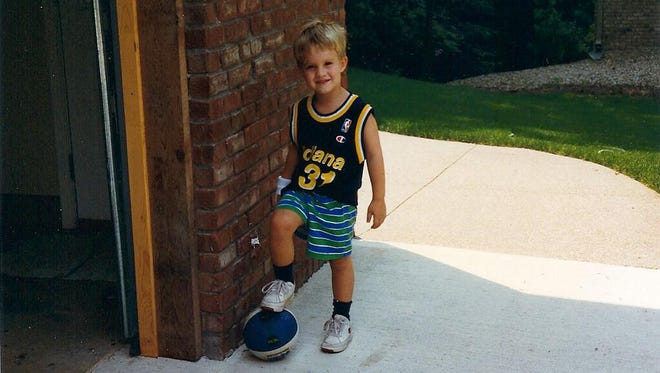 The No. 1 ranked amateur golfer in the world, Patrick Rodgers, donning a Reggie Miller jersey when he was 4 years old.