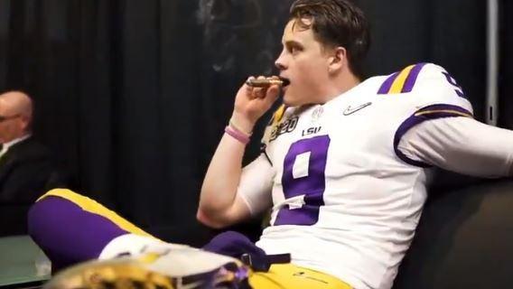 LSU quarterback Joe Burrow celebrates a college football nationship with a victory cigar.
