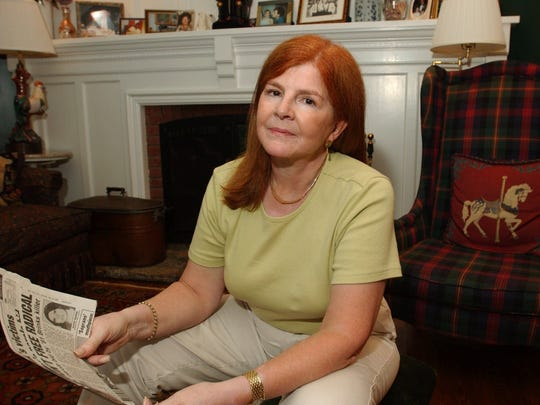 Norma Hill, a witness to the Oct. 20, 1981, Brinks armored car robbery that left a guard and two policemen dead, holds newspapers covering the 1984 trials of those apprehended in the crime,  home Monday, Aug. 13, 2001. Hill is now trying to help free Kathy Boudin, who is serving 20 years to life in prison for her part in the robbery. Boudin is scheduled for a parole hearing on Aug. 22. (AP Photo/Louis Lanzano)