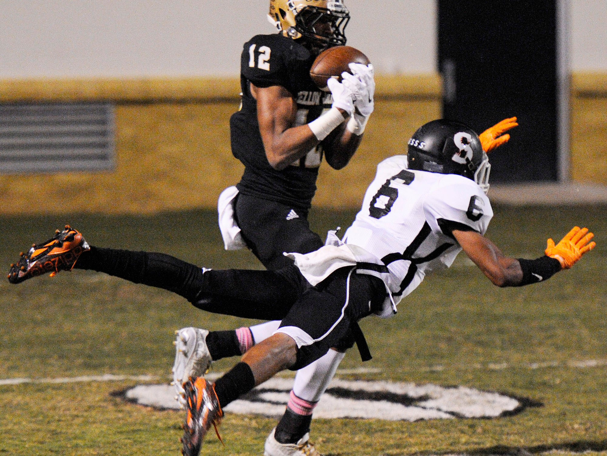 Greer's Dorian Lindsey (12) catches a touchdown pass despite the efforts of Southside's Keenan Stephens (6).