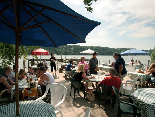 The outdoor dining area of the Bayside Pub in Webster