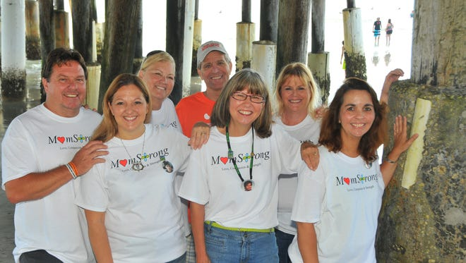 """The National Kidney Foundation of Florida in 2015 honored """"donor moms"""" who gave kidneys to children. Mike Futch, Dawn Futch, Dee Hill, Bill Hahn, Mary Carpenter, Julie Newhouse and Pat Brown."""
