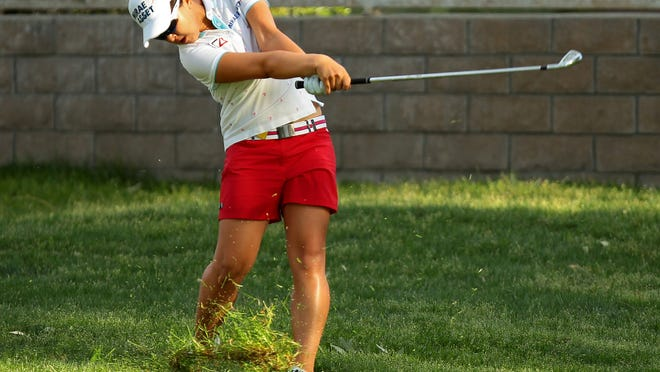 Sei Young Kim of Korea hits her second shot out of the rough on the fifteenth hole Sunday during the final round of the ANA Inspiration in Rancho Mirage, Calif. Kim started the day with a five shot lead and held the lead at the turn, but had two double bogeys and four bogeys in her final round. She also had five birdies, and finished tied for fourth at seven under.