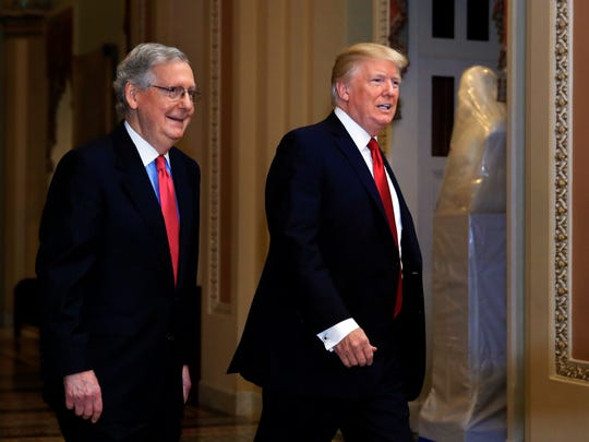 President Donald Trump and Senate Majority Leader Mitch McConnell of Ky., walk at the U.S. Capitol in Washington, Tuesday, Oct. 24, 2017. Trump was attending a luncheon with Republican senators.