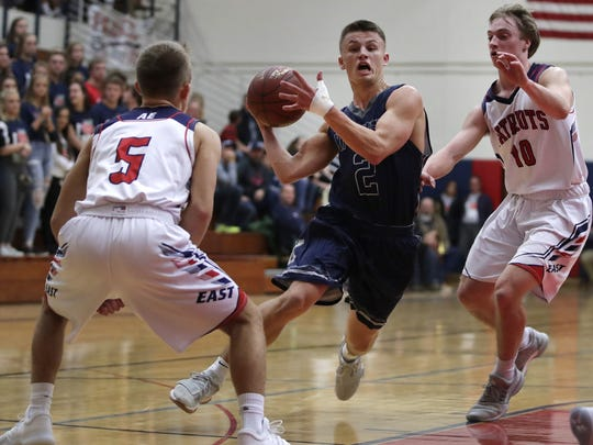 Appleton Xavier's Hunter Plamann works his way to the basket during a game against Appleton East High School at the Big Apple Classic last week.