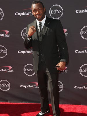 News10 is getting ready for its March 2 broadcast of the Oscars by looking back at the glamour and glitz of the red carpet at awards shows of the past year. In this photo, boxer Austin Trout attends The 2013 ESPY Awards at Nokia Theatre L.A. Live on July 17, 2013 in Los Angeles, California.