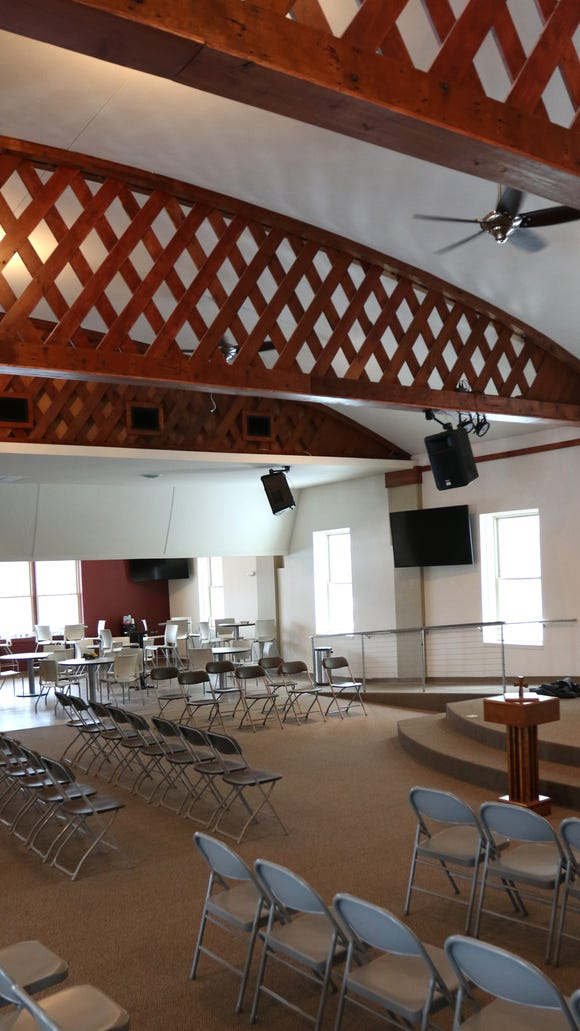 The bare support beams have been converted into a decorative styling inside The Word, a new church in downtown Stevens Point that has been converted from an old night club, which even featured dancing poles.