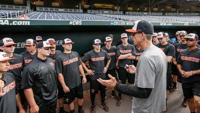 Oregon State coach Pat Casey addresses his players in the dugout before team practice in Omaha, Neb., Friday, June 16, 2017. Oregon State is on the cusp of joining the company of the greatest college baseball teams of all time. At 54-4, the Beavers enter the College World Series with the fewest losses of any team since 1982.