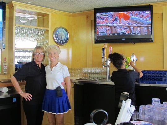 Duffers bar manager Jackie Carlino, left, and co-owner Joanne Martunas behind the bar at the new sports bar at Lakewood Country Club, 4235 Lakewood Blvd., in East Naples.
