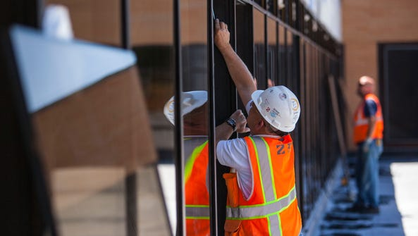 Construction crews work on changes to the Sharwan Smith