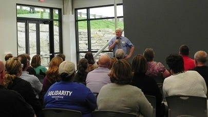 Rep. Glenn Grothman speaks with employees of Metalcraft of Mayville during a visit on Oct. 11.