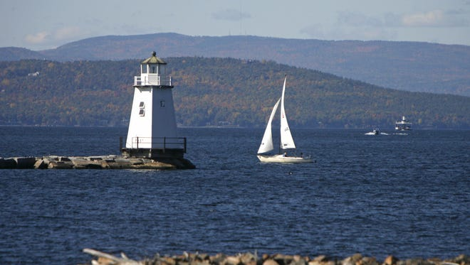 In this Oct. 10, 2008 file photo, boats travel across the waters of Lake Champlain in Burlington, Vt.