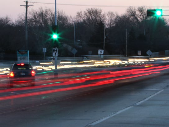 Traffic on Moorland Road is a river of light in both