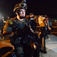 Armed police in riot gear move in to make arrests as demonstrators protest the shooting death of Michael Brown in Ferguson, Mo., on August 19, 2014. Protestors took to the streets of Ferguson, Missouri for another day to voice their outcry over the police slaying of an unarmed black teenager in Ferguson, Missouri.  EPA/LARRY W. SMITH ORG XMIT: LWS125