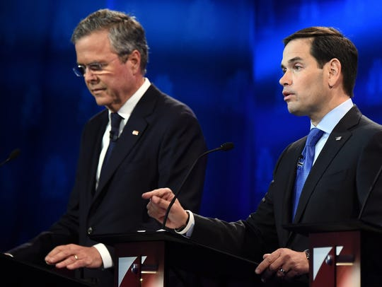Republican Presidential hopeful Marco Rubio, right,