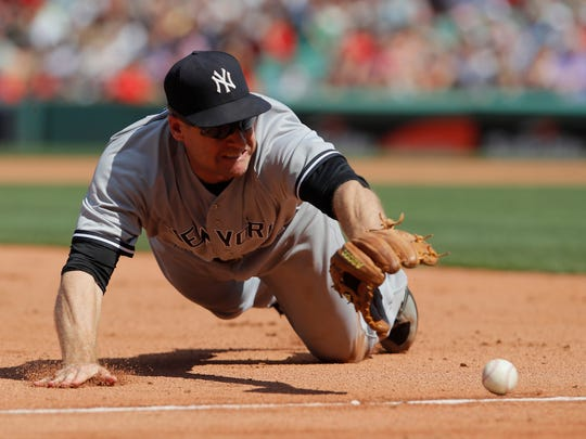 Jul 16, 2017; Boston, MA, USA; New York Yankees third baseman Chase Headley (12) makes the stop at third base against the Boston Red Sox in the seventh inning at Fenway Park.