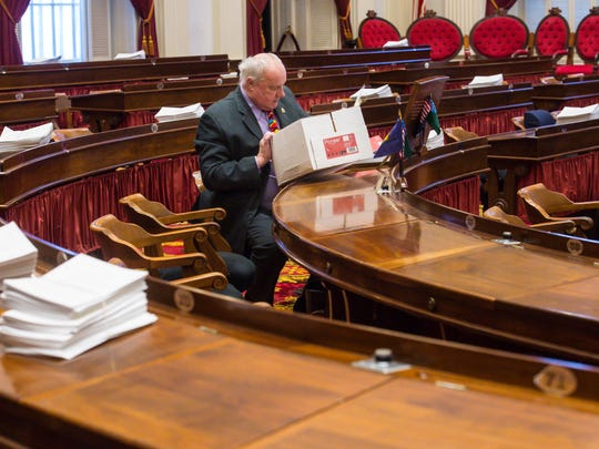 Rep. Gary Viens, R-Newport, moves into his desk on the floor of the House of Representatives on the opening day of the legislature at the State House in Montpelier on Wednesday, January 3, 2018.