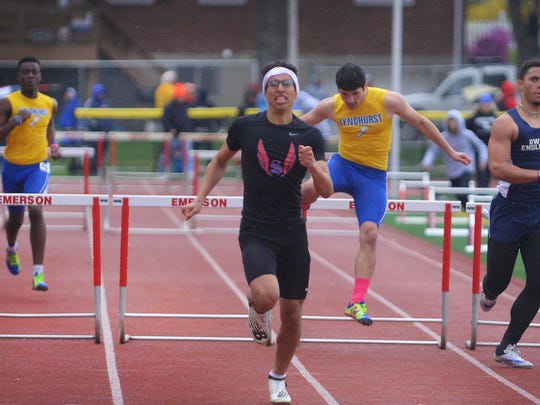 Adam Khriss of Secaucus finishes first in the 400 meter hurdle in the Liberty heat during the NJIC Liberty and Patriot Track meet at Emerson High School in Emerson on 04/30/18.