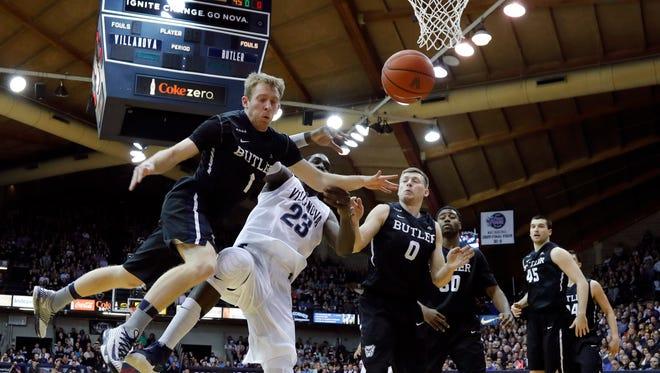 Butler's Tyler Lewis (1) and Villanova's Daniel Ochefu (23) collide chasing a rebound during the first half of an NCAA college basketball game, Saturday, Feb. 20, 2016, in Villanova, Pa.