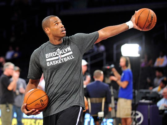 February 23, 2014; Los Angeles, CA, USA; Brooklyn Nets newly signed player Jason Collins practices before playing against the Los Angeles Lakers at Staples Center. Mandatory Credit: Gary A. Vasquez-USA TODAY Sports