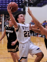 Wylie's Shayden Payne (22) drives the lane during a game last season. Payne has taken over point guard duties for the Bulldogs this season and is building off his experience from a year ago.
